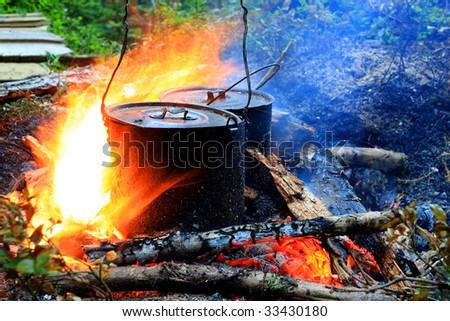 Two tourist kettles on fire - stock photo