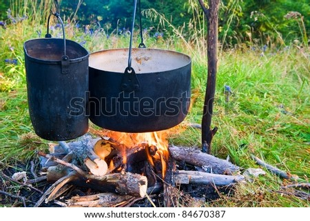 two touristic cauldron in a fire