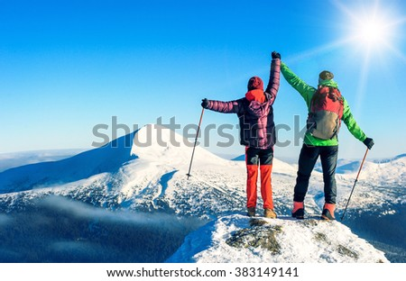 Two tourists reaching the summit. Active sport concept - stock photo