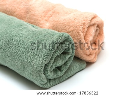 two towels braided in a tubule on the white - stock photo