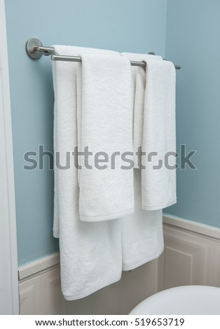 Two towels hanging on the Clothes line.Clean white towels on a hanger.white towel in bathroom, home.Bathroom Towel - white towel on a hanger prepared to use