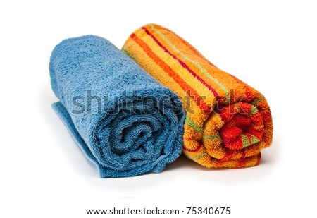 Two towels rolled up on a white background - stock photo