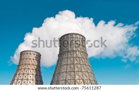 two towers against the blue sky - stock photo