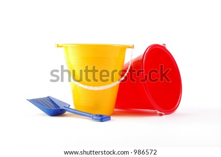 Two toy buckets and shovel on white background - stock photo