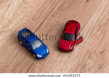 two toy cars on desk - stock photo