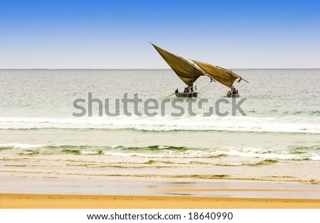 two traditional arabic fishing dhows  in Mozambique - stock photo