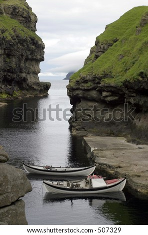 Two traditional boats in a natural harbour, Faroe Island - stock photo