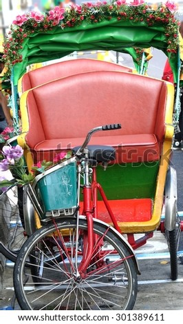 Two traditional cycle rickshaws or pedicabs are parked by the side of the road in Taiwan  - stock photo
