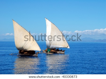 Two traditional dhow boats sailing - stock photo