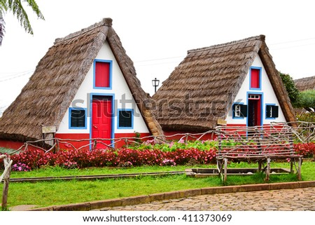 Two traditional Santana houses in Madeira, Portugal - stock photo