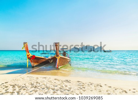Two traditional thai longtail wooden boats at famous sunset Long Beach, Thailand, Koh Phi Phi Don island, Krabi province, Andaman sea