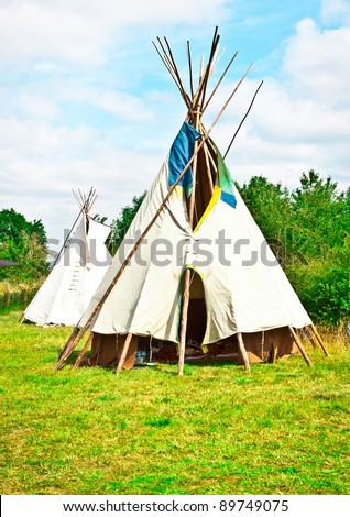 Two traditional wigwams at a festival in the UK