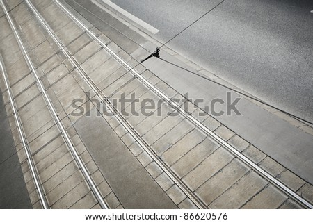 Two tram tracks on road. - stock photo