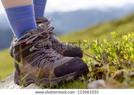 two tramping boots bevore mountain landscape - stock photo