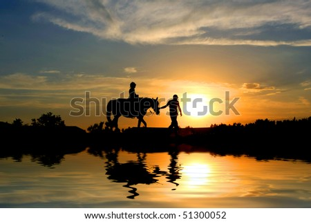 Two travelers on sunset background - stock photo
