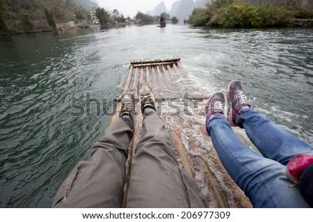 two travlers rafting in Lijiang,guilin china - stock photo
