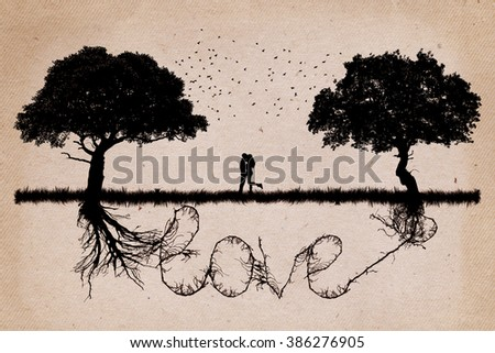 Two trees in front of each other growing in love relationship and romance concept with underground roots merge together in shape of love word. Relationship and togetherness - stock photo