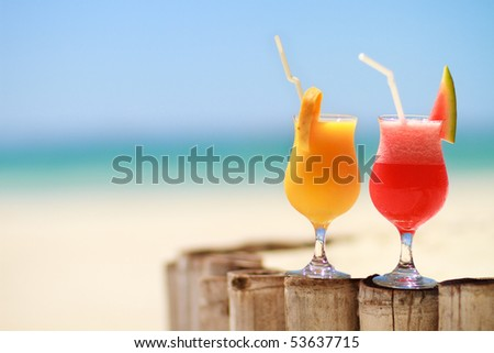 Two tropical fresh juices on tropical beach - stock photo