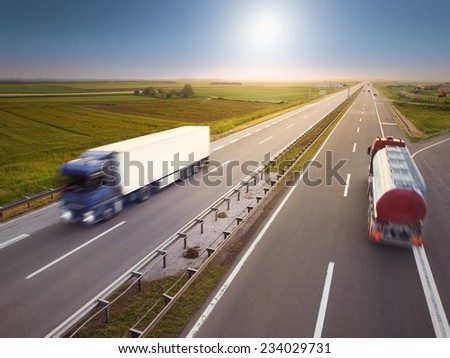 Two trucks in motion blur on highway at idyllic sunny day near Belgrade - Serbia - stock photo