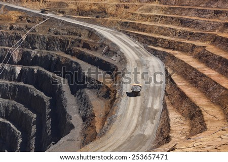 Two trucks transport gold ore from open cast mine. Barrick Cowal Gold Mine in New South Wales,  Australia. - stock photo