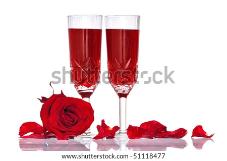 two tumblers with red wine and rose as a symbol of love