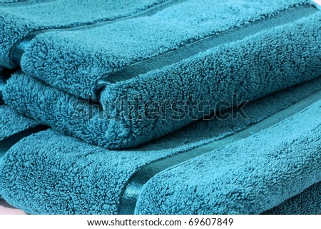 Two turquoise towels close up - stock photo
