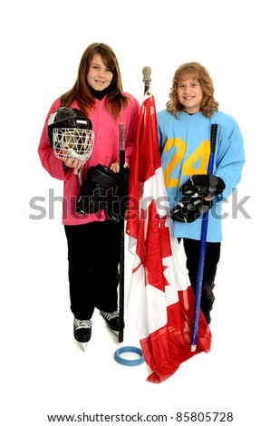 Two tween Canadian Girls with Ringette Equipment