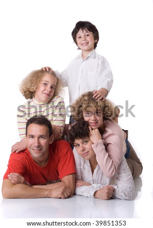 Two twins (girls) and boy  with parents on white background