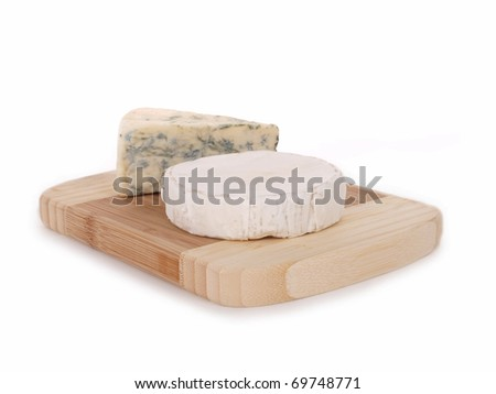 Two types of cheese on wooden platter, isolated on a white background - stock photo