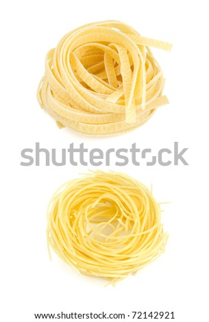Two types of italian pasta isolated on white - stock photo