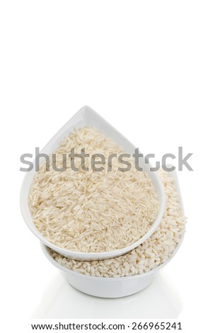 Two types of rice in a white bowl on a white background (close-up) - stock photo