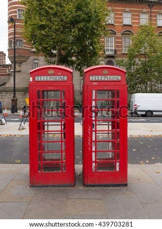 Two typically english red phone booths in London - stock photo