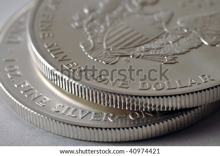 two U.S. Silver Eagle coins - stock photo