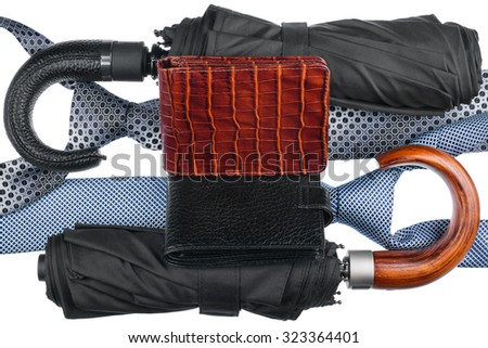 Two umbrellas and two tie and  two purse, isolated on white background - stock photo