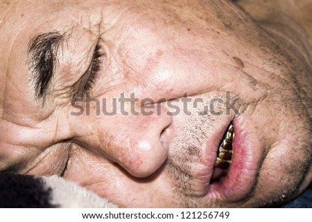 two uncles were asleep after drinking alcohol - stock photo