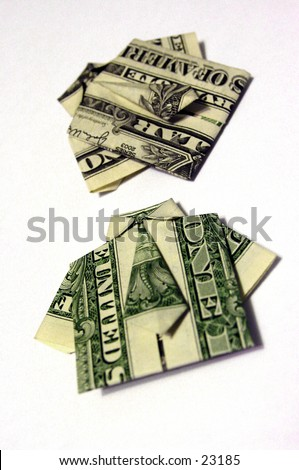 Two United States dollar bills folded origami style into a shirt and tie - stock photo