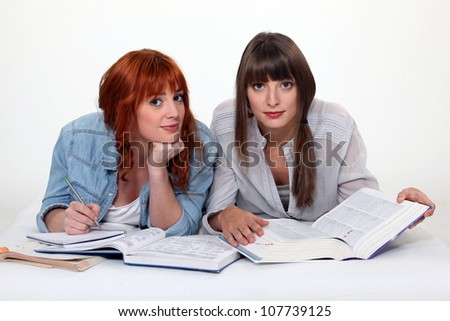 Two university students revising for exam - stock photo