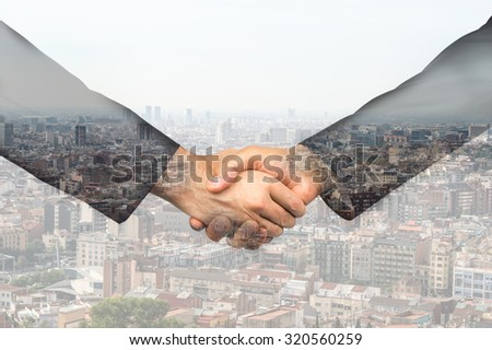 two unrecognizable businessmen shaking hands superimposed over a cityscape - stock photo