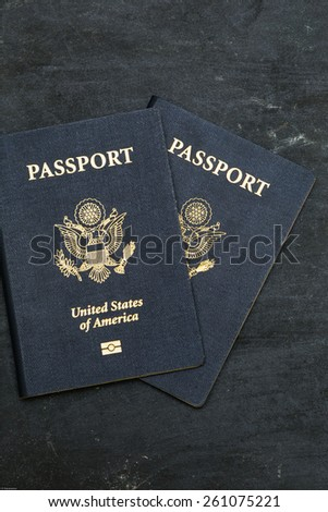 Two US passports on black background. American citizenship. Traveling around the world. - stock photo