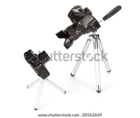 Two various modern digital cameras on a white background. Concept for a choice problem - stock photo