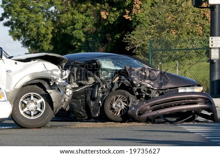 Two Vehicle accident at a busy intersection - stock photo