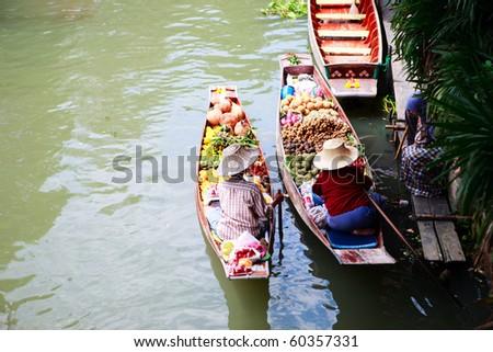 Two vendors on Damnoen Saduak Floating Market near Bangkok in Thailand - stock photo