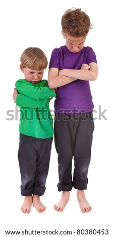 Two very angry boys against white background - stock photo