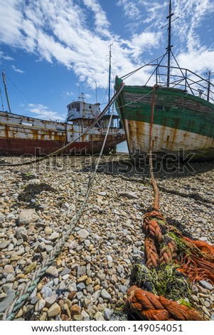 two very old fishing boats - wrecks - stock photo