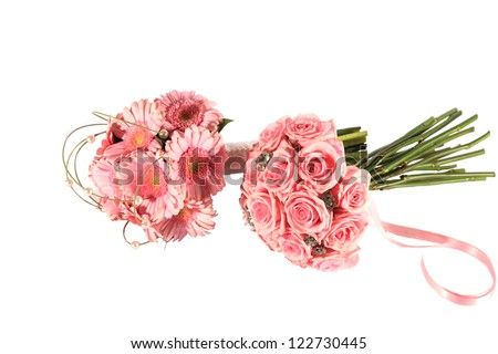 Two very pink bouquets including gerberas and roses - stock photo
