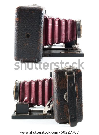 Two views of an antique bellowed film camera on an isolated white background. - stock photo