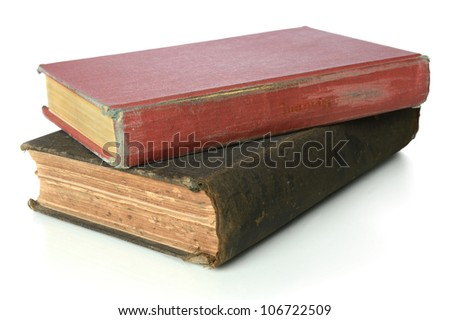Two vintage books stacked together isolated over white background - stock photo