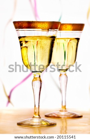 Two vintage champagne glass with golden engraved stripe on the top - stock photo