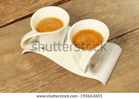 Two Vintage Cups of Espresso on Grungy Wooden Table, with space for text or image. - stock photo