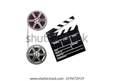Two vintage 8mm purple and grey movie reels vertically connected with film and clapper board isolated on white background - stock photo